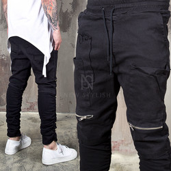 Distressed wrinkled black bending pants