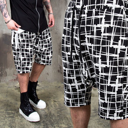 Unbalanced check pattern banding shorts