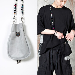 Ethnic drawstring suede cross bag